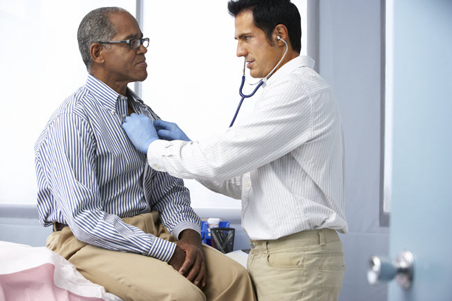 Doctor Listening to a Patients Heart.