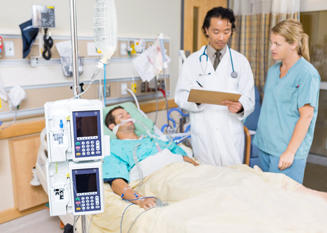 Patient in Hospital with Nurse and Doctor.