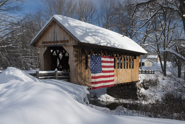 New England Snow Covered Bridge With US Flag.